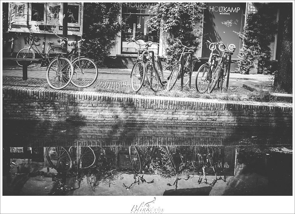 Bikes reflected in a Delft canal.
