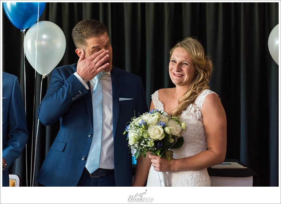 Groom cries at the sight of his bride.