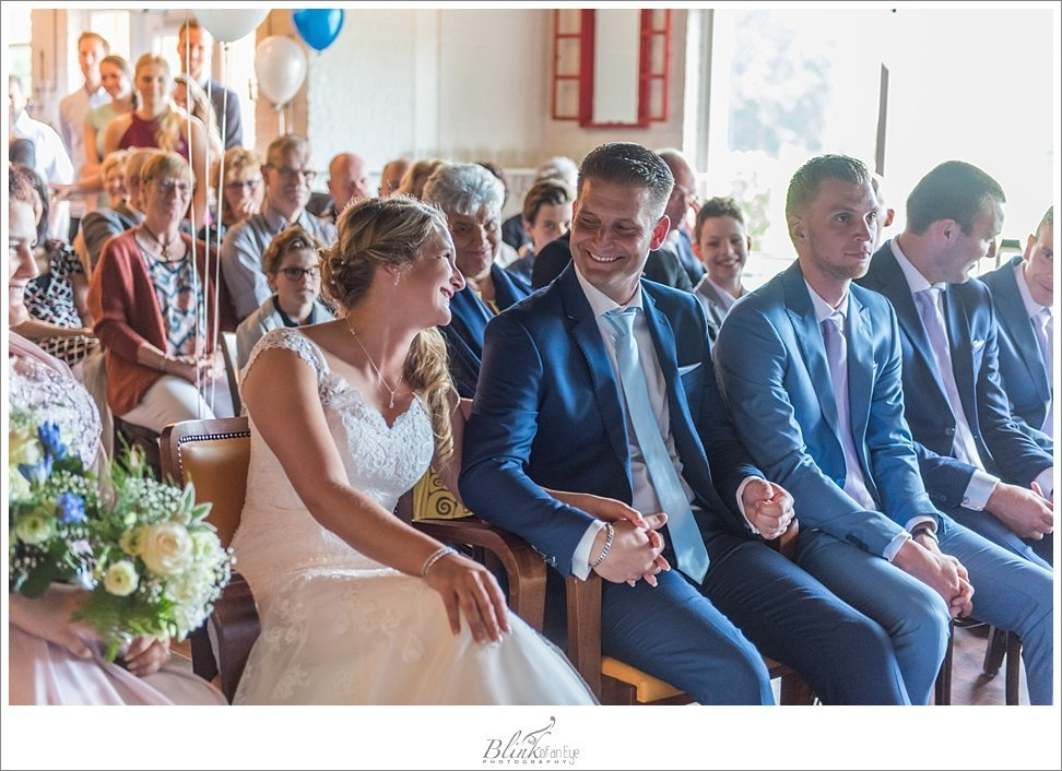 Delft Bride and Groom share a laugh during their wedding ceremony at Onder Ons Party Centrum.