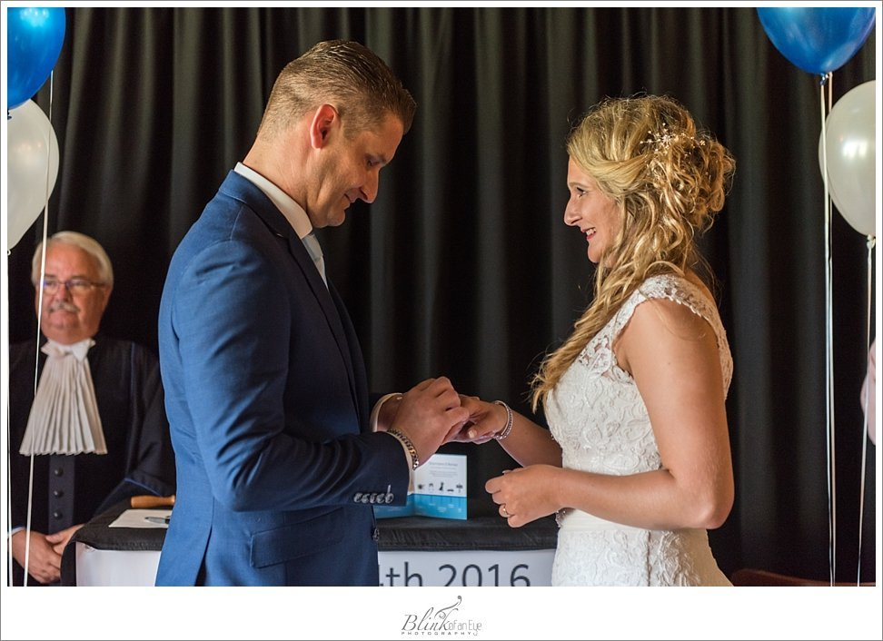 Bride and Groom exchange rings at Delft wedding.