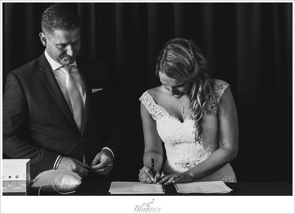 The signing of the official marriage papers by the Bride and Groom during Deflt wedding ceremony.