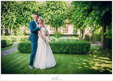 Bride and Groom in beautiful Delft garden, Hof van Delft.