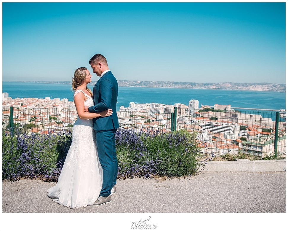Bride and Groom pose above the city of Marseille, France.