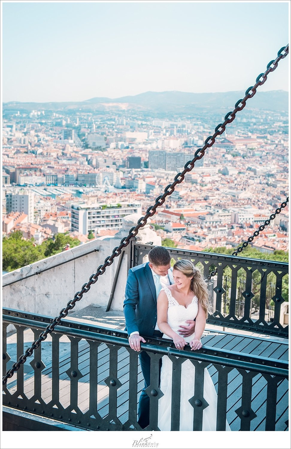 Marseille, France at the feet of the bride and groom during post wedding photo shoot In Marseille!