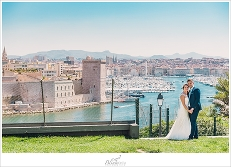 Bride and Groom in front of the harbor in Marseille France.