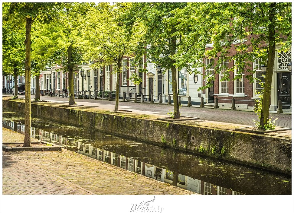 Walking along the canal in Delft.