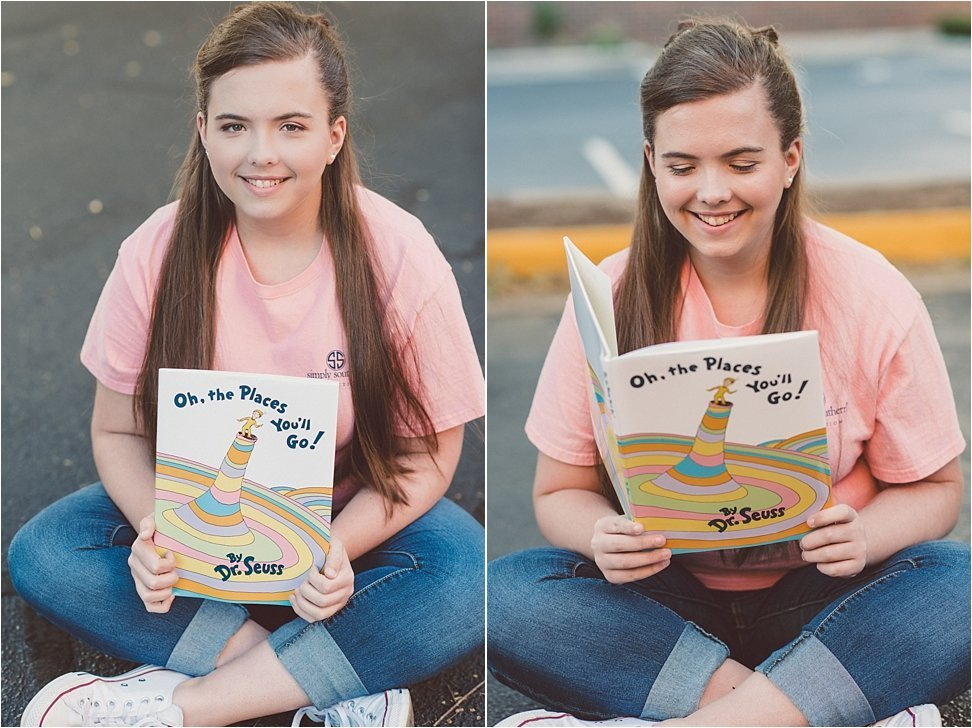 Senior girl poses with book in Burlington, NC