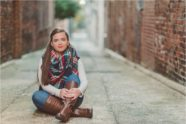 This blanket scarf pops in senior session photo in alley of Burlington, NC.