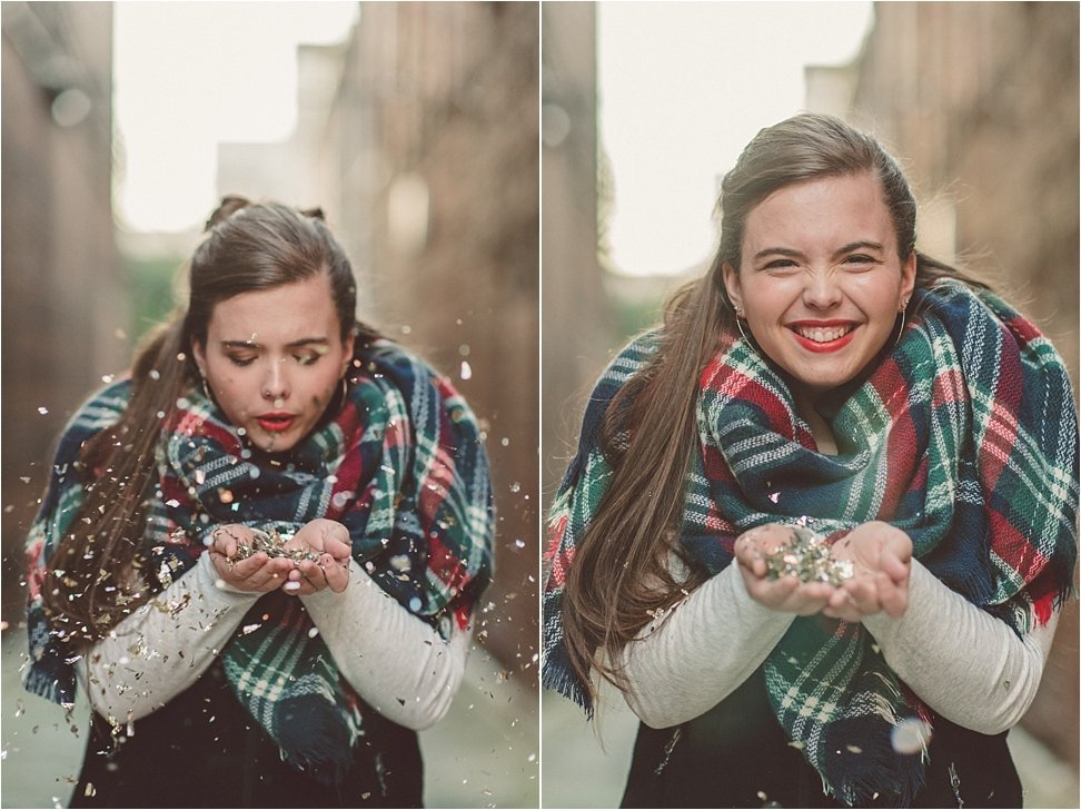 Blowing confetti during Beauty Revived Senior Session in NC.