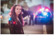 Senior pose in downtown, making use of traffic lights and a cop car. She rocked it.