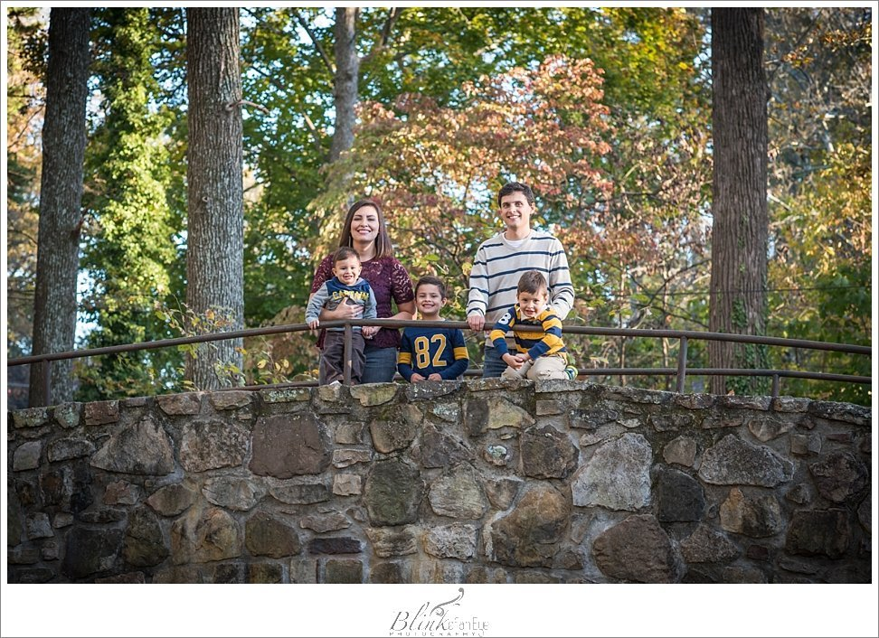 Family on bridge in Greensboror's Lindley Park.