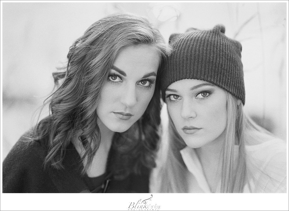 Black and white film portrait of gorgeous sisters.