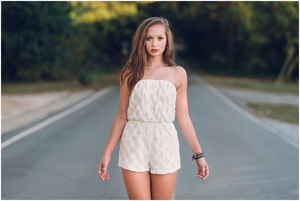 Raleigh high school senior strikes a pose on the streets of Glencoe Mill Village
