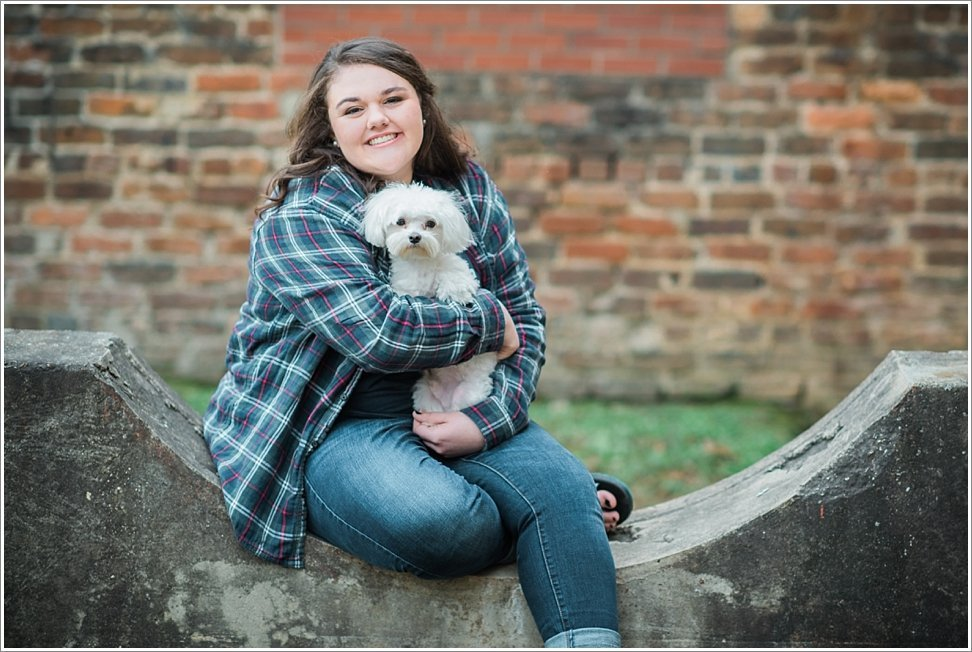 Posing with her dog, this senior shines during her Beauty Revived Senior Session.