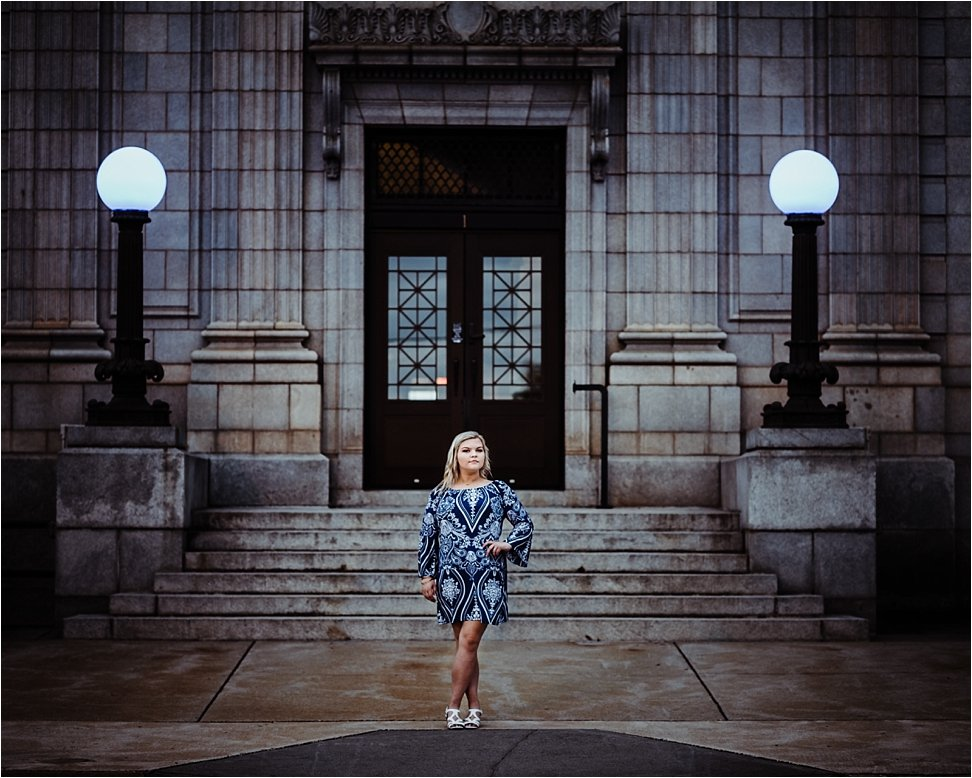 Moody senior portrait showcasing courthouse in Graham, NC