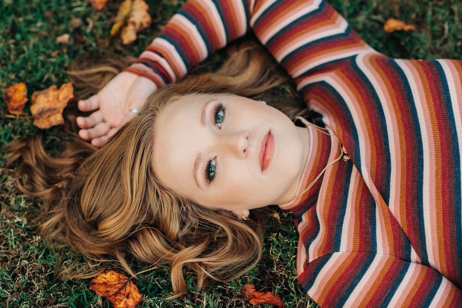 Stunning laying down pose fall senior portrait!