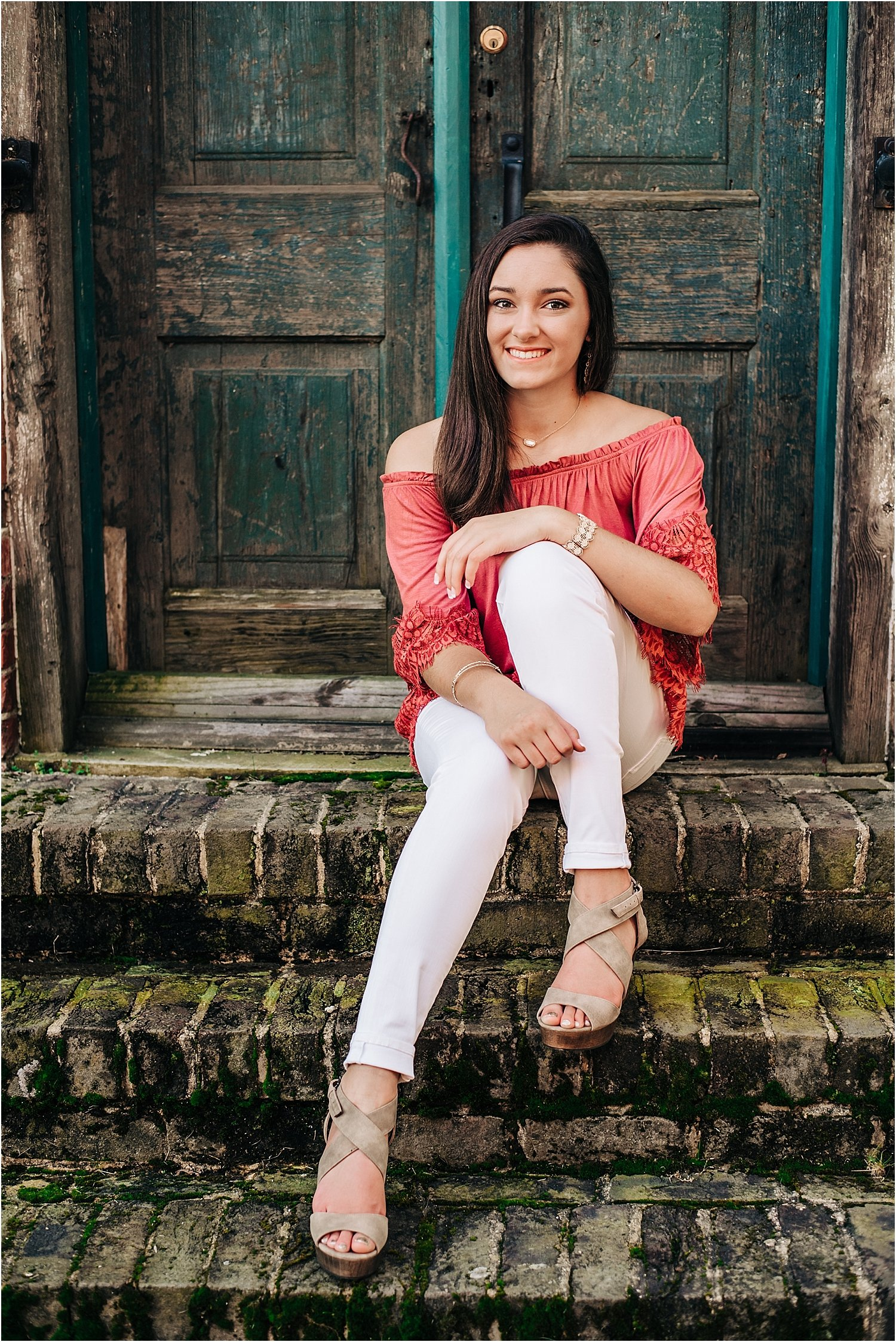 Senior portrait with colorful, rustic backdrop.
