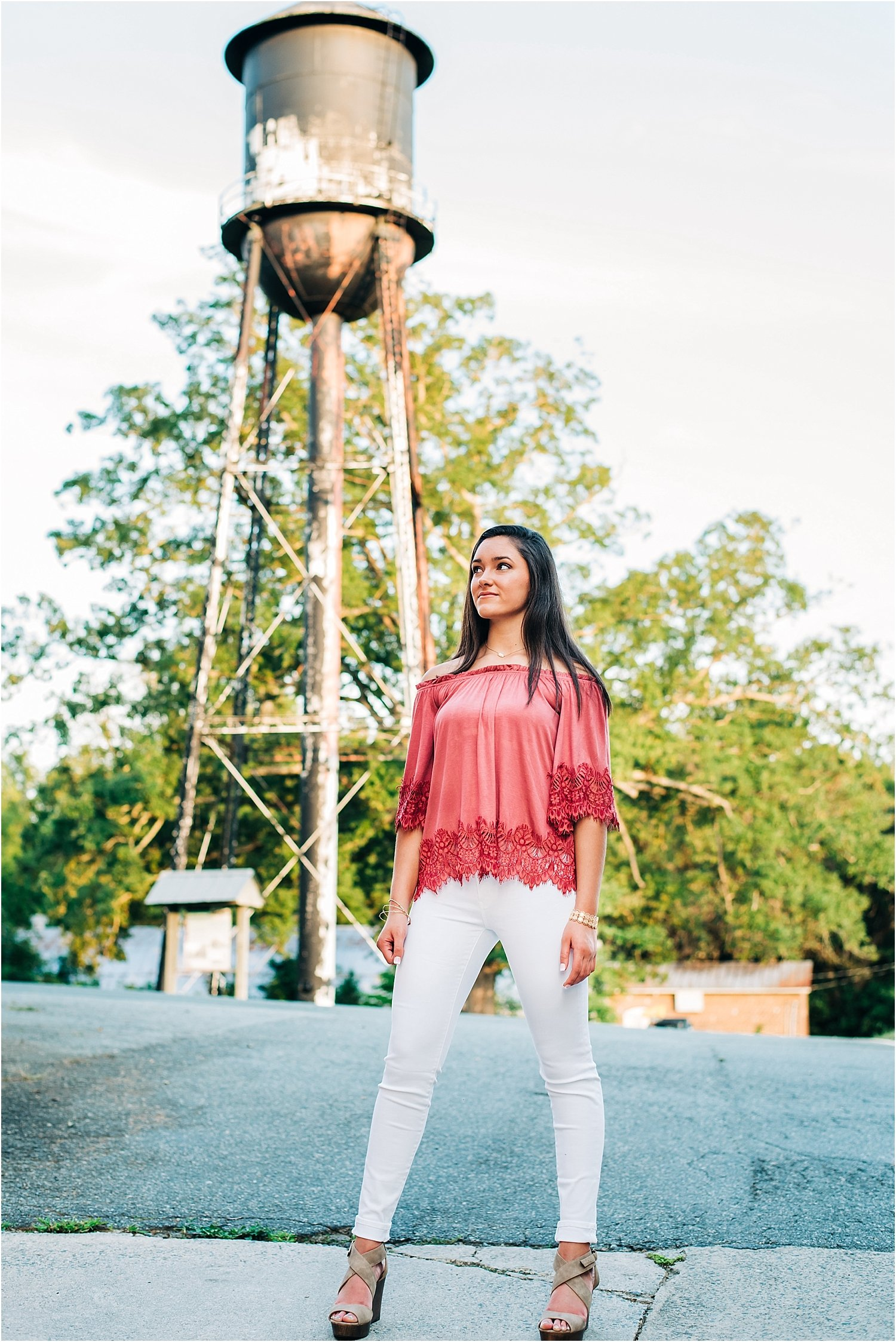 Senior pose in front of Glencoe water tower.