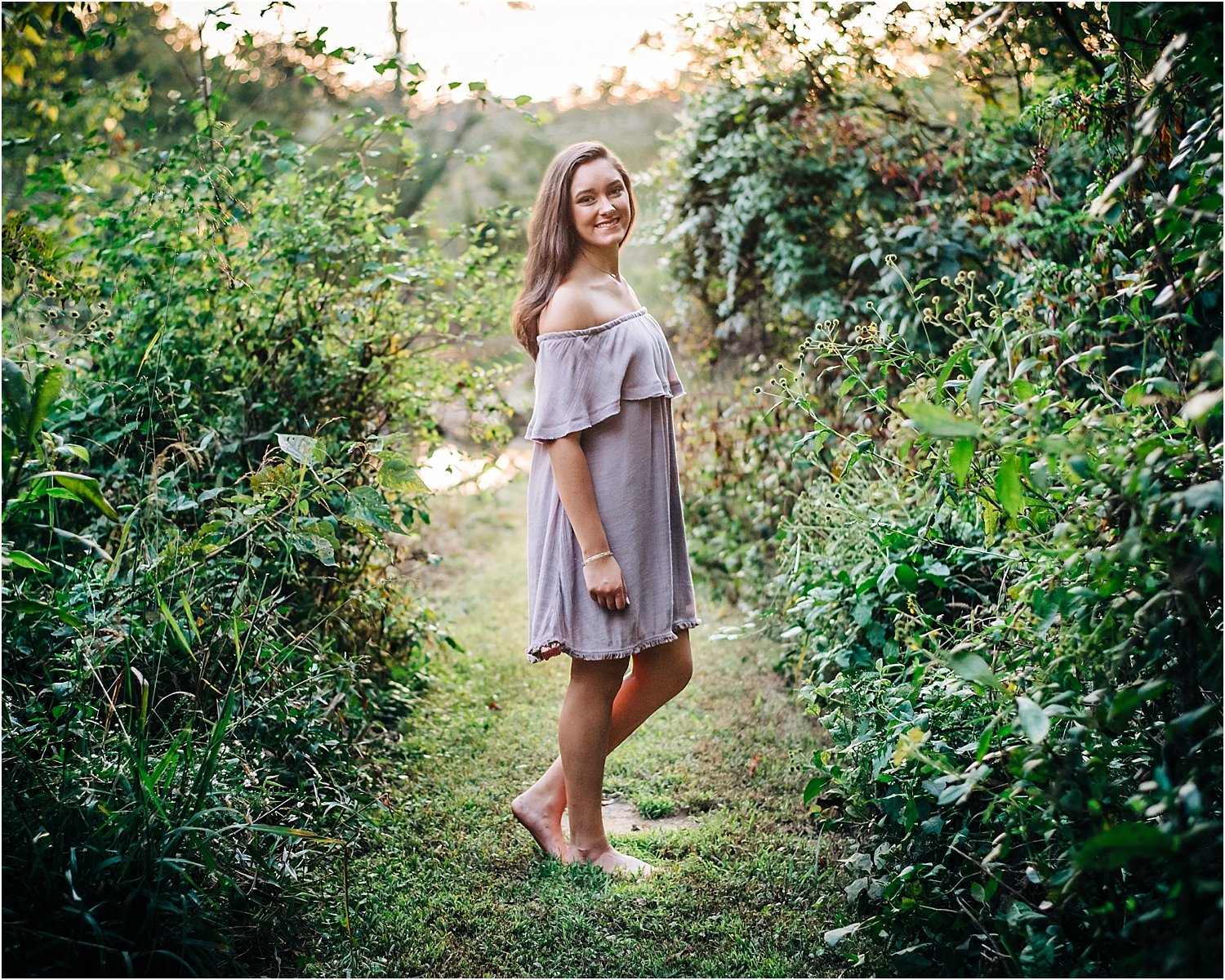 A lovely trail provides a gorgeous backdrop for senior portrait.