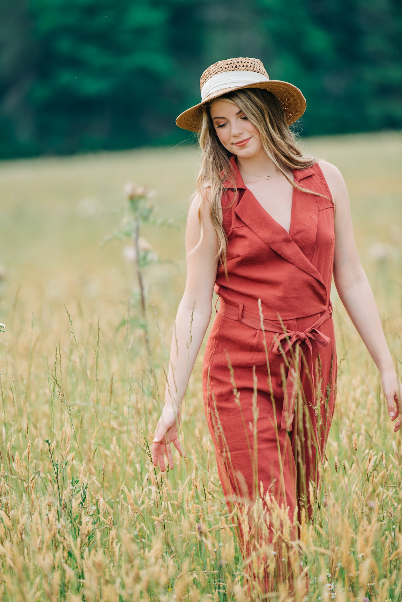 Lovely young woman walking through a country field in Burlington, NC